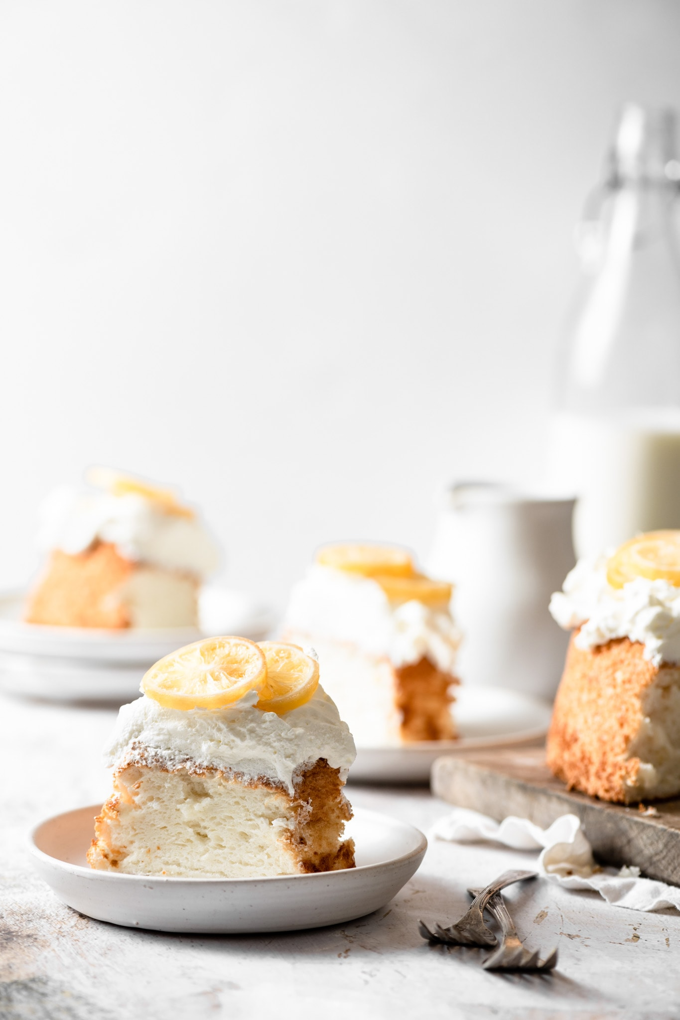 Slices of angel food cake topped with lemons.