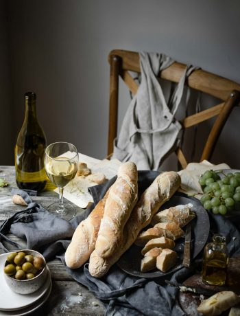 Homemade French Baguette Recipe with grapes and olive oil.