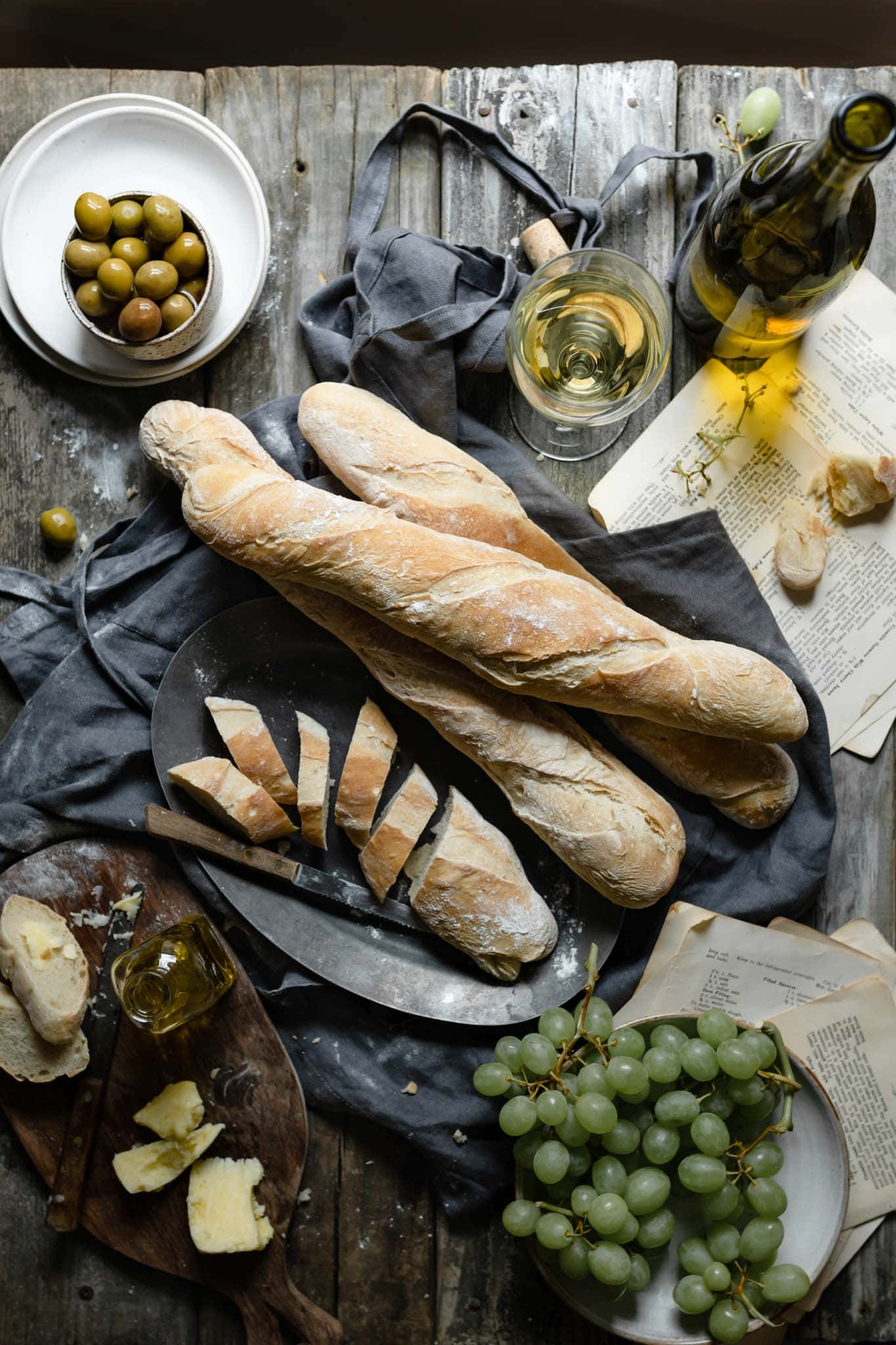 Homemade french baguettes with olives and olive oil.