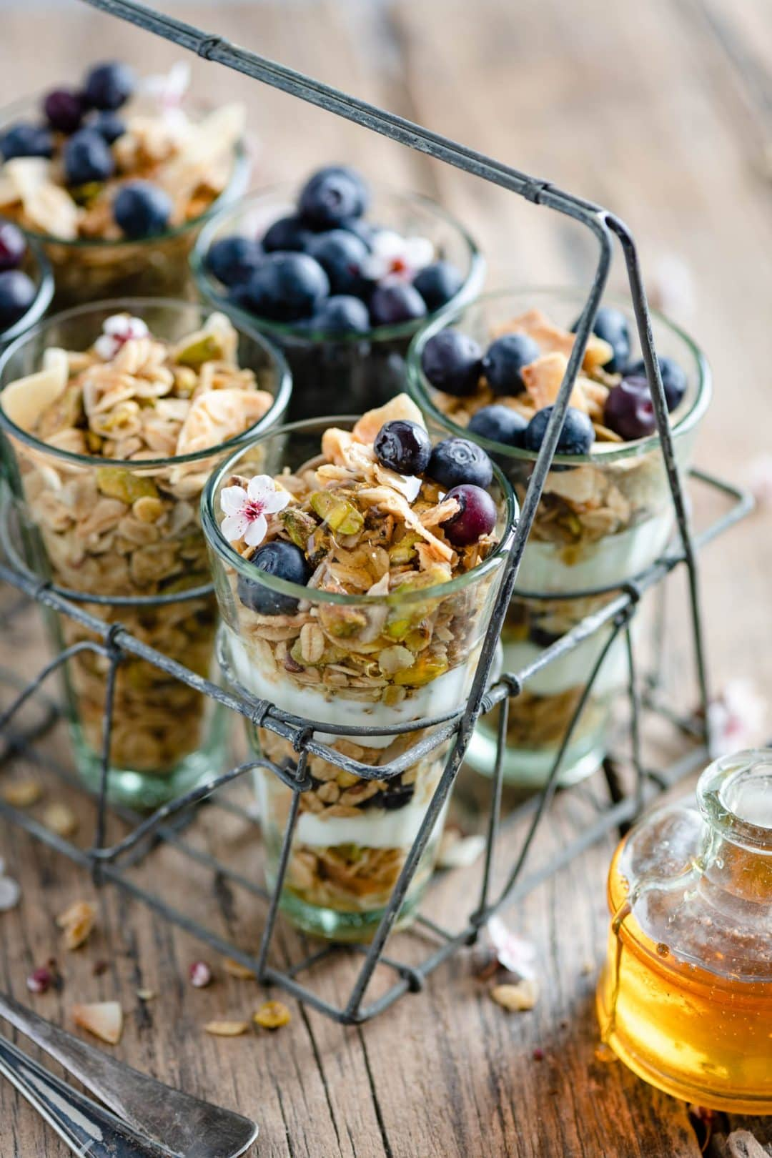 Coconut Granola Parfaits with pistachio and blueberries.