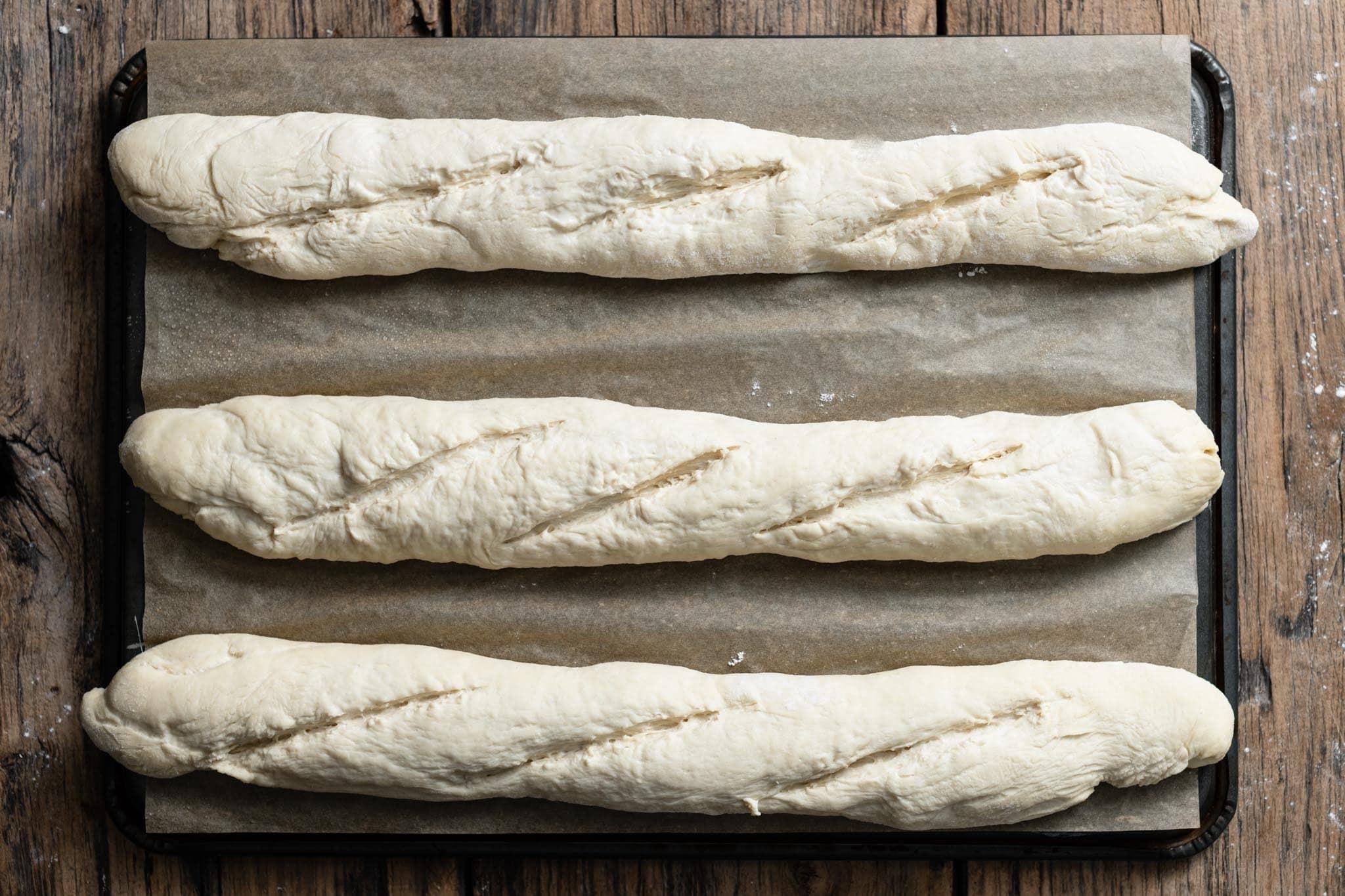French Baguette dough sliced for baking.