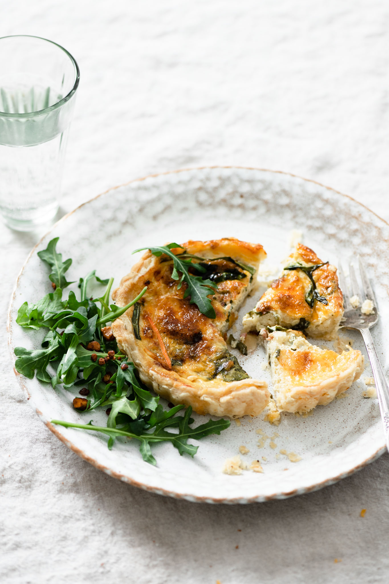 Breakfast quiche with an arugula salad.