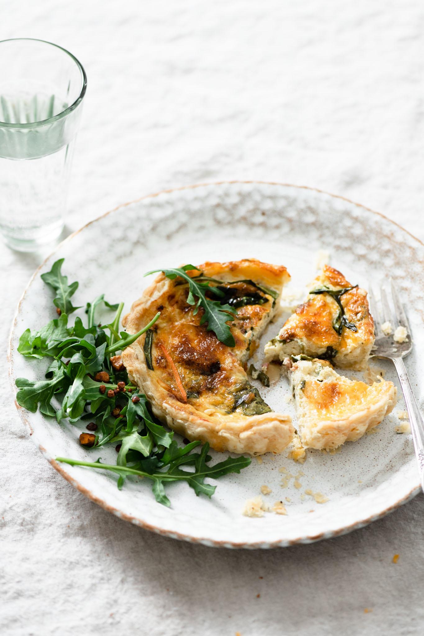 Breakfast quiche with an arugula salad.