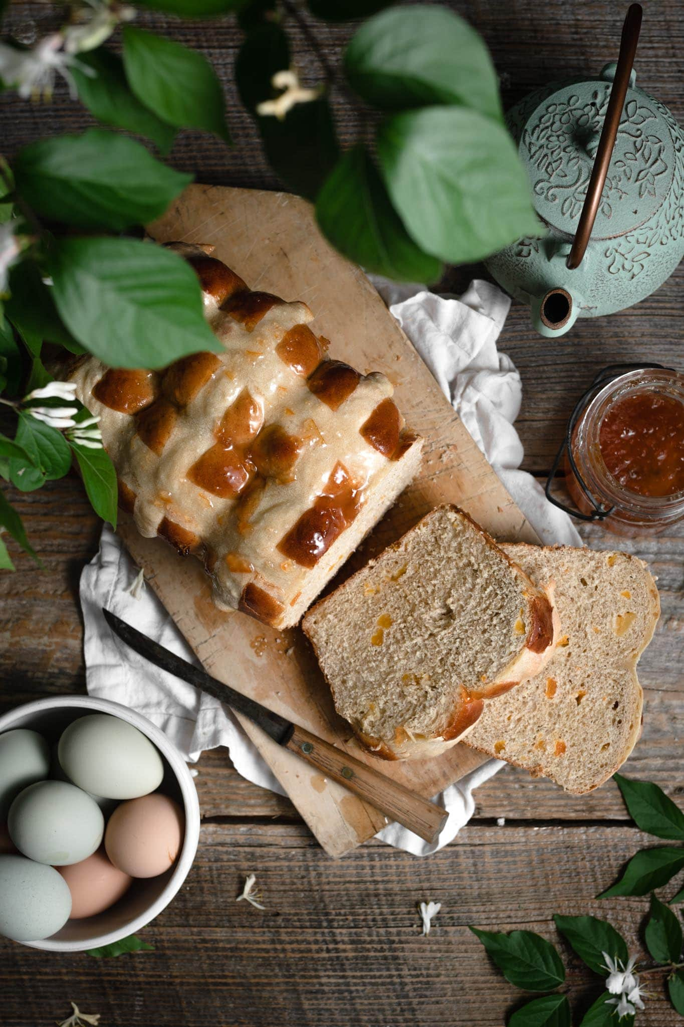Hot cross buns loaf with apricot jam and honey.
