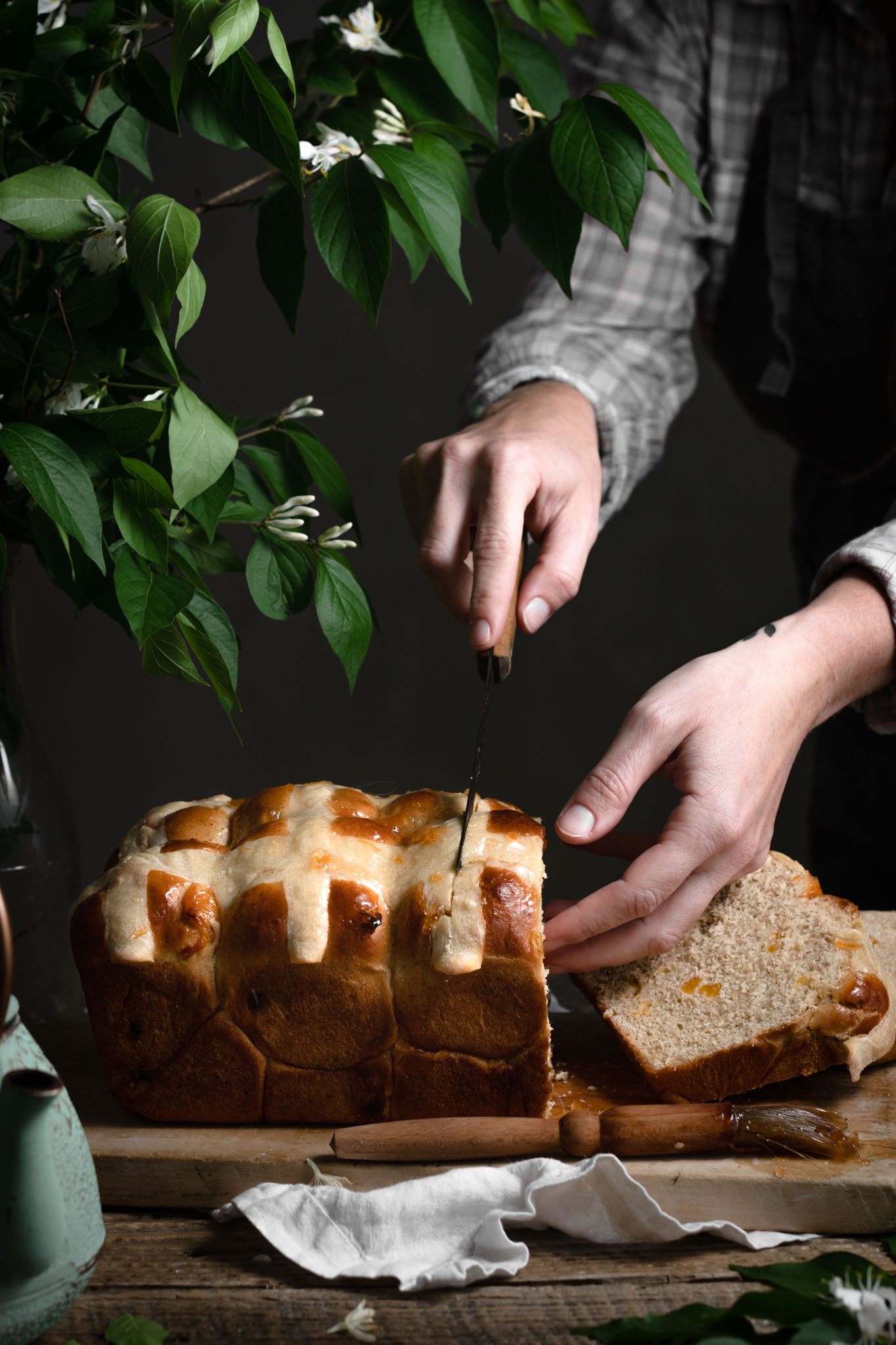 Slicing hot cross buns loaf recipe for Easter.