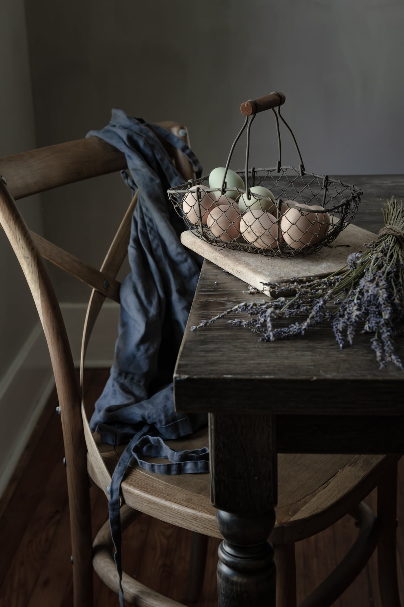 Spring colored eggs and fresh lavender on table.