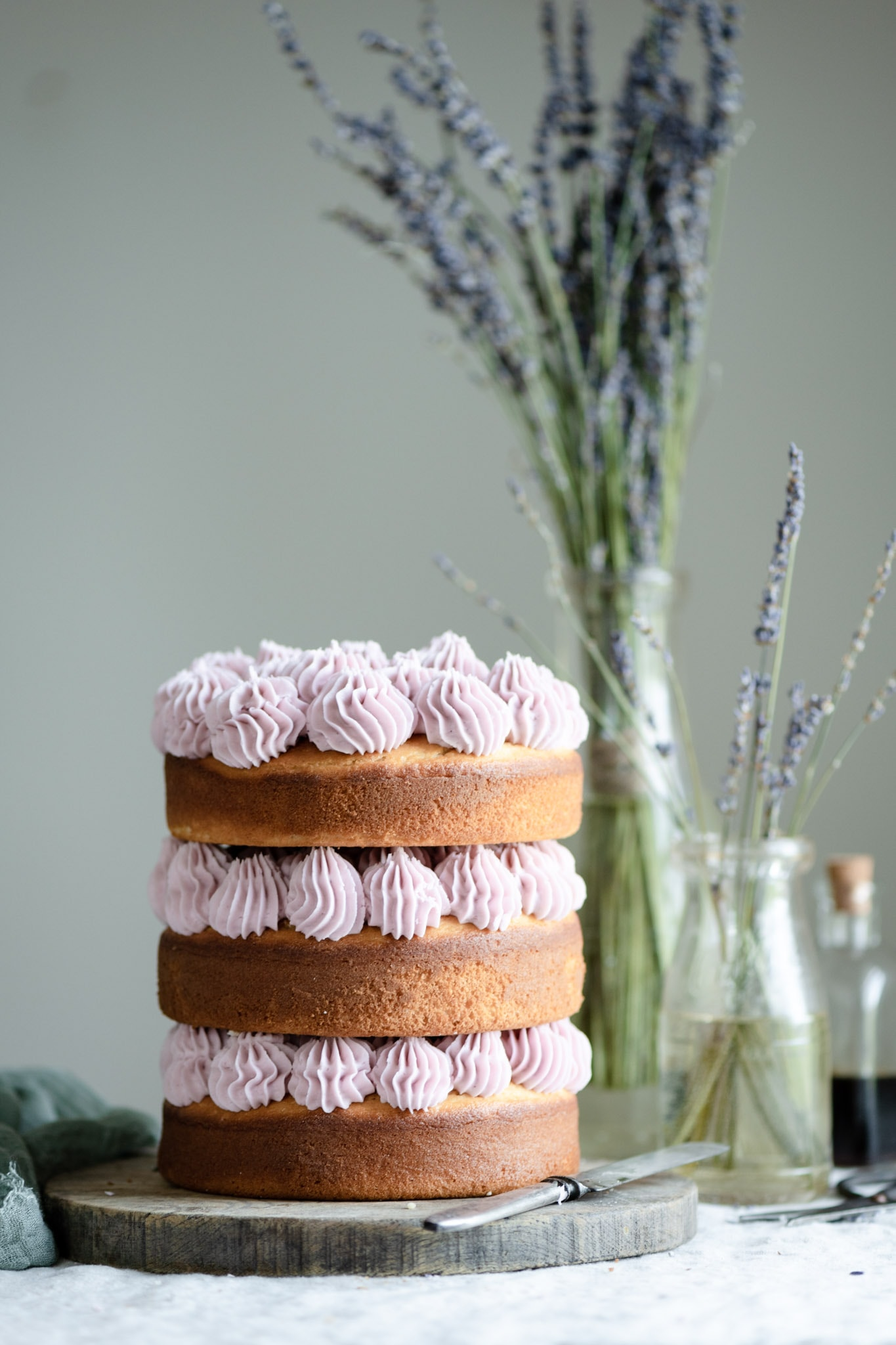 Layered vanilla cake with purple frosting.