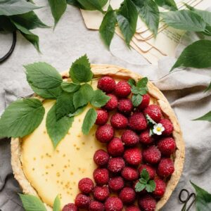 Homemade Lemon curd cheesecake with fresh raspberries.