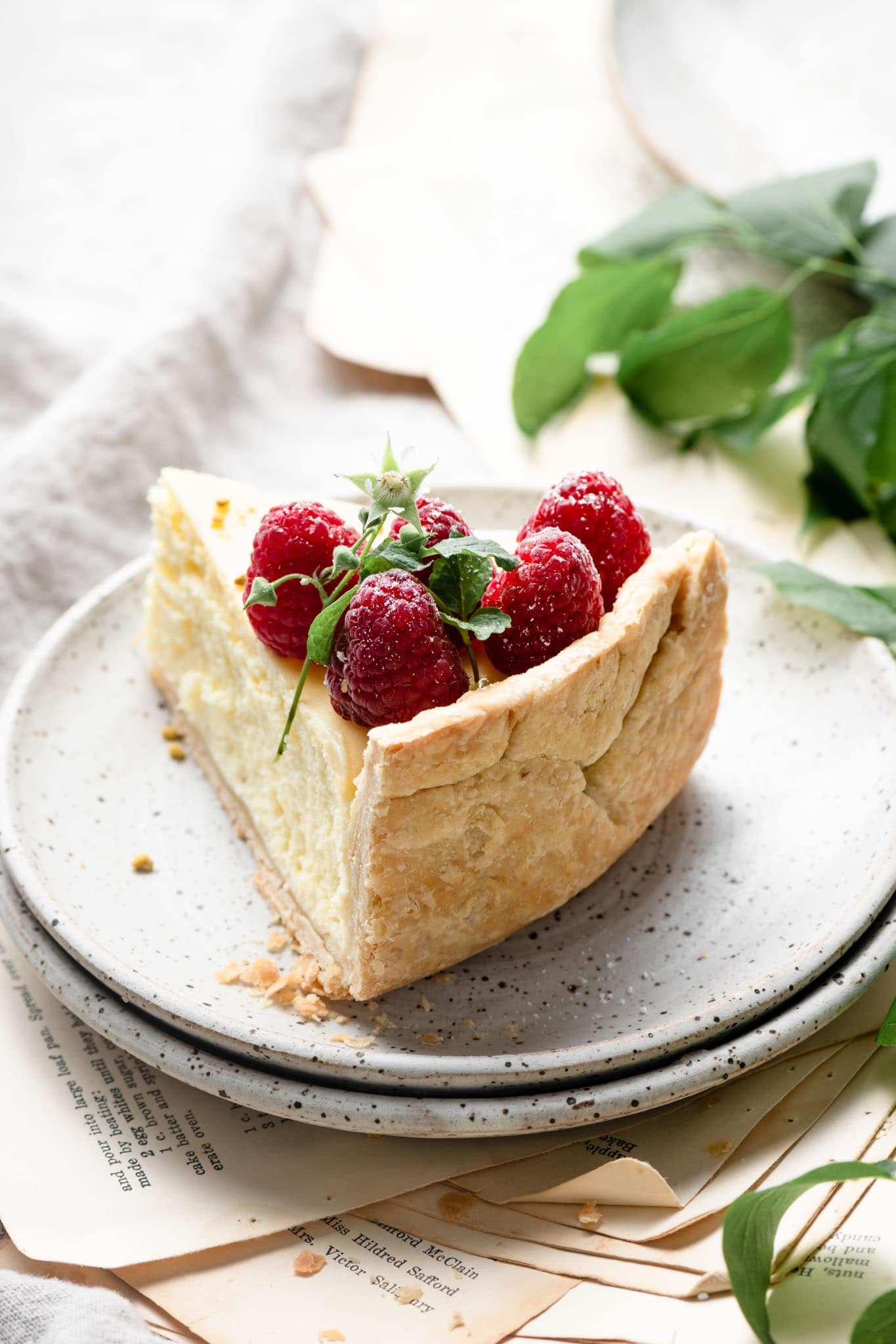 Lemon Curd Cheesecake Recipe with flaky pie crust.