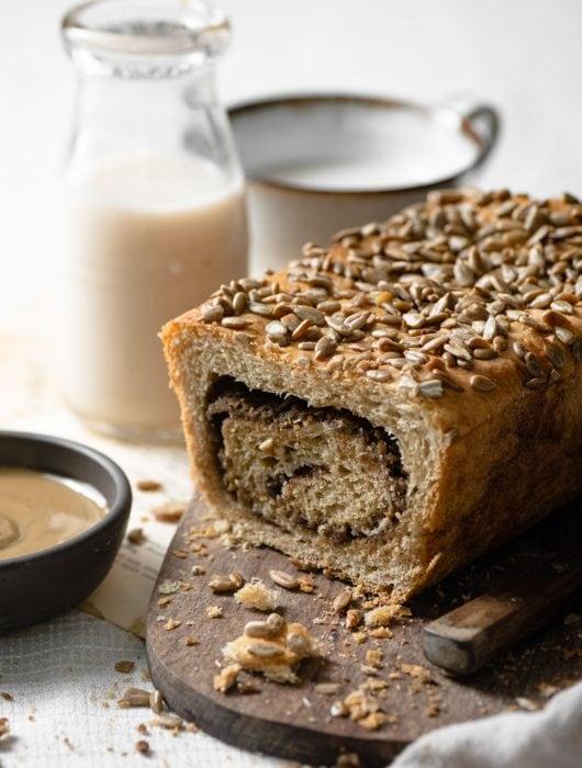 Homemade cinnamon swirl bread with creamy sunflower butter.