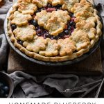 Homemade blueberry rhubarb pie with flaky pie crust.