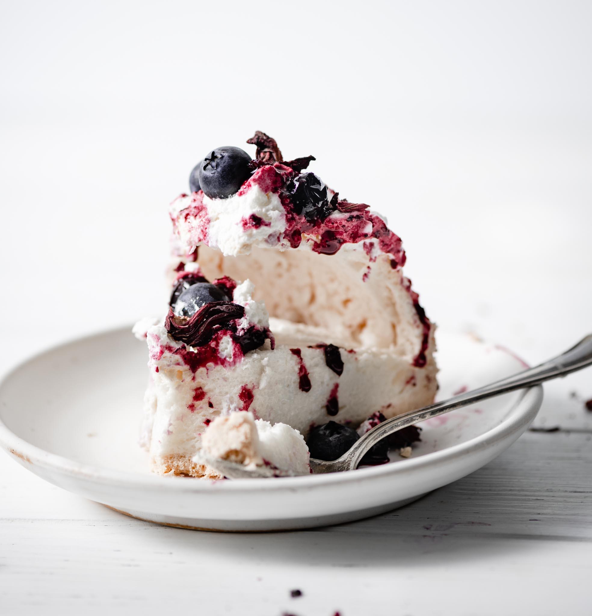 Sliced blueberry compote pavlova cake.