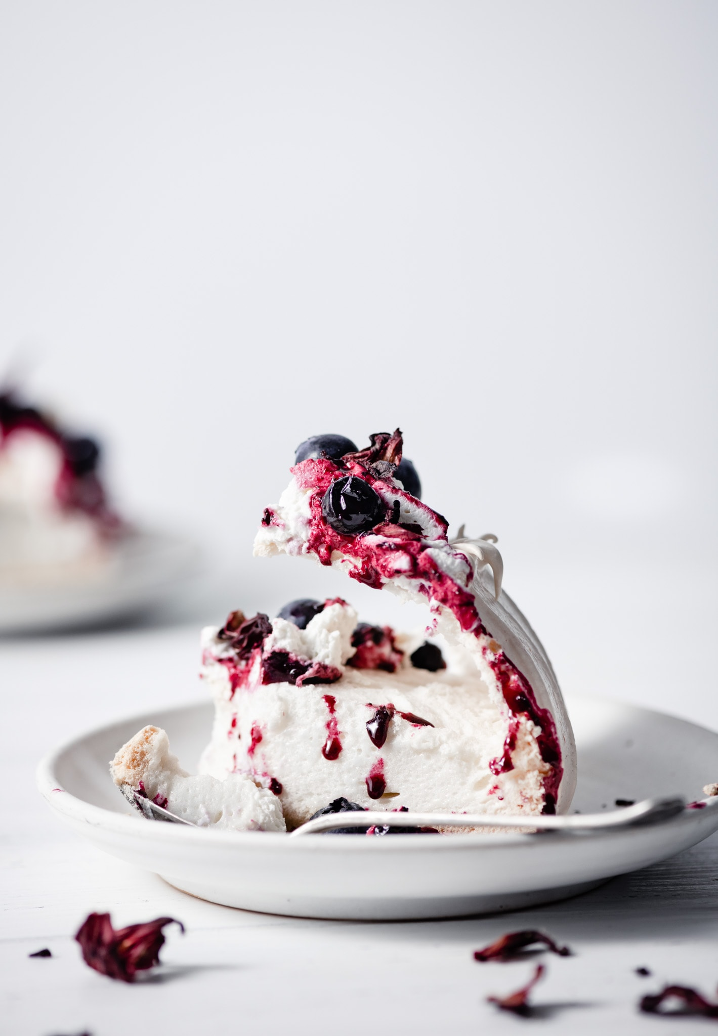 Marshmallow center meringue cake with blueberry compote.