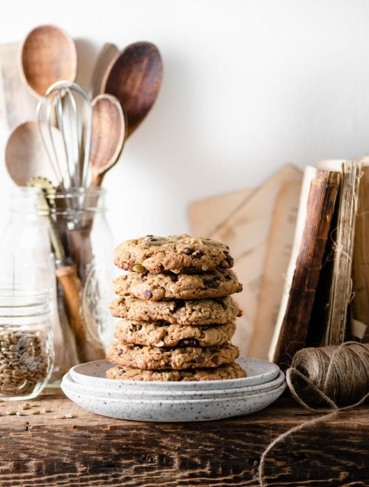 Stack of chewy oatmeal cookies on shelf.