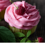 Lemon cupcakes with pink frosting.