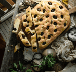 Focaccia bread sliced with olives.