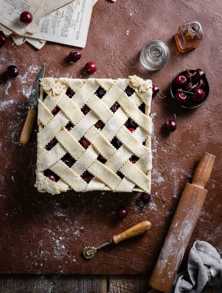 Unbaked cherry pie with lattice crust.