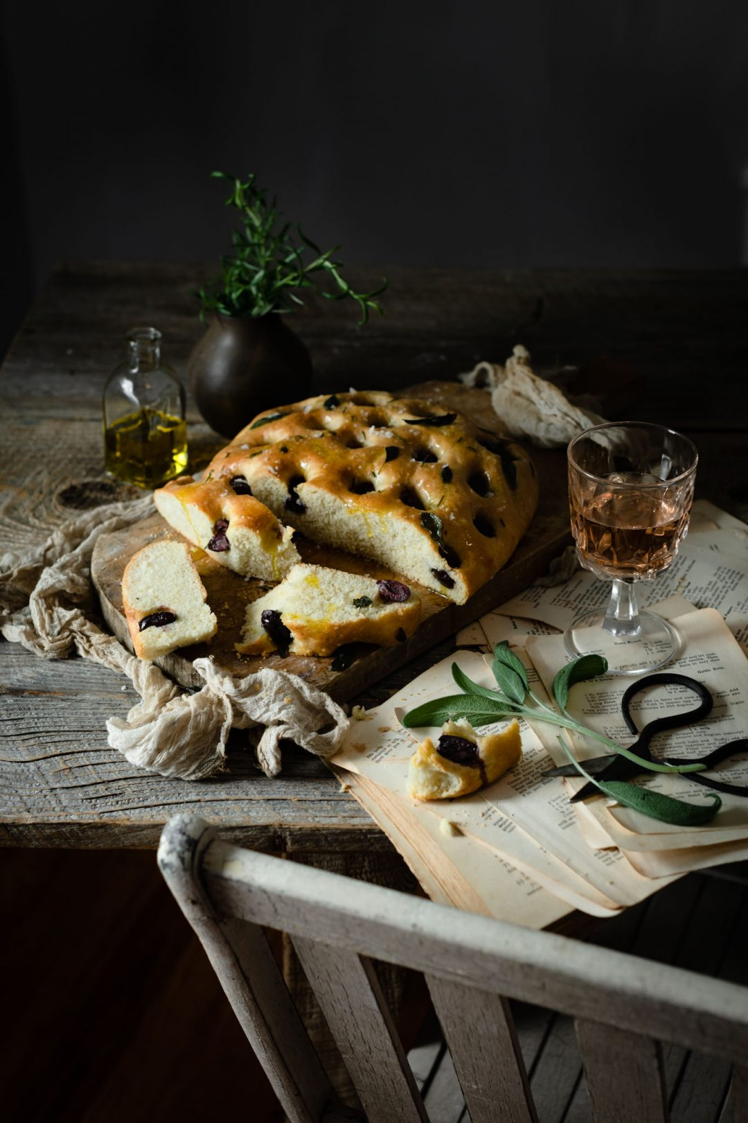 Focacci olive bread sliced on table.
