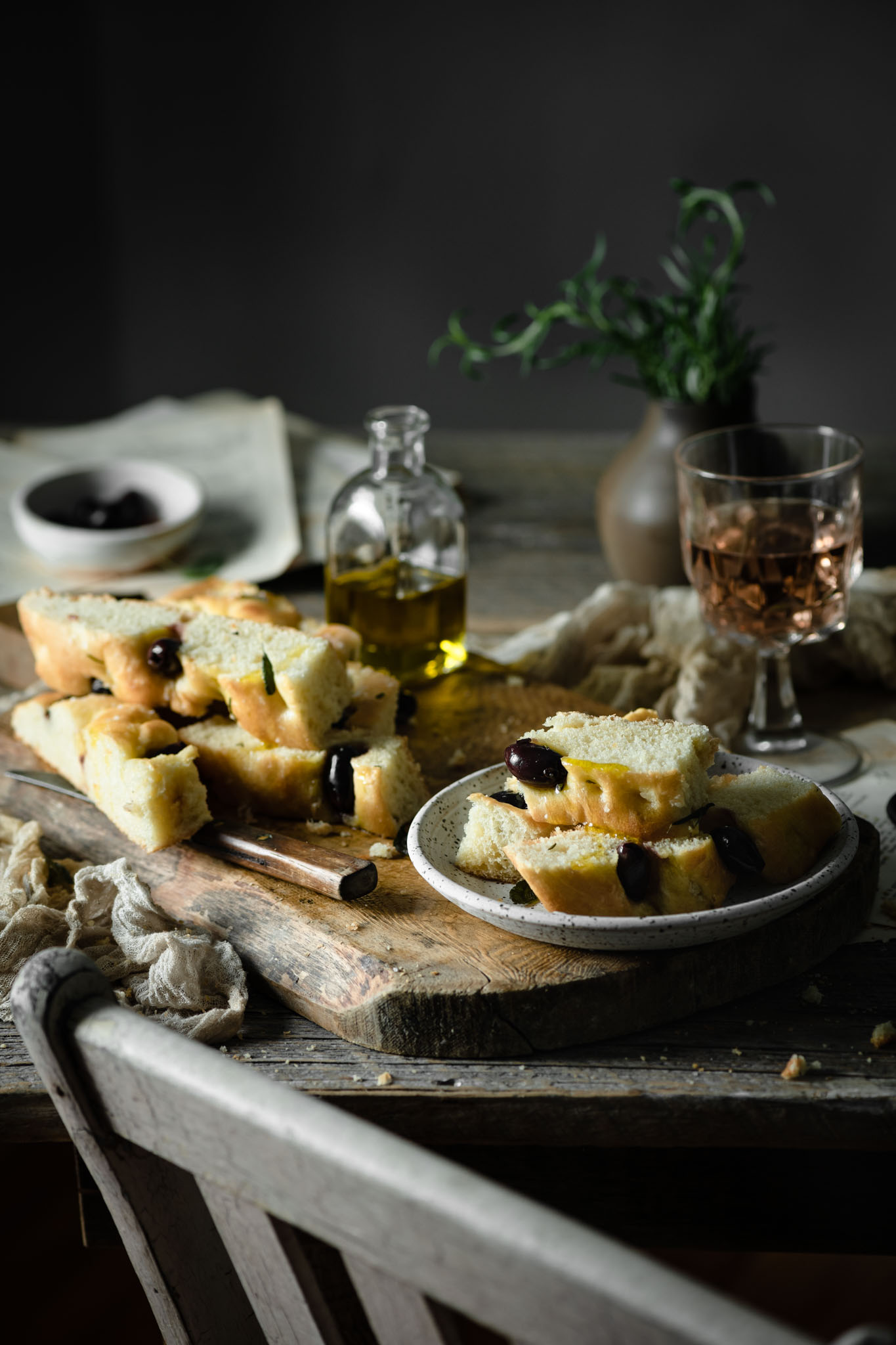 sliced focaccia bread on plate with wine.