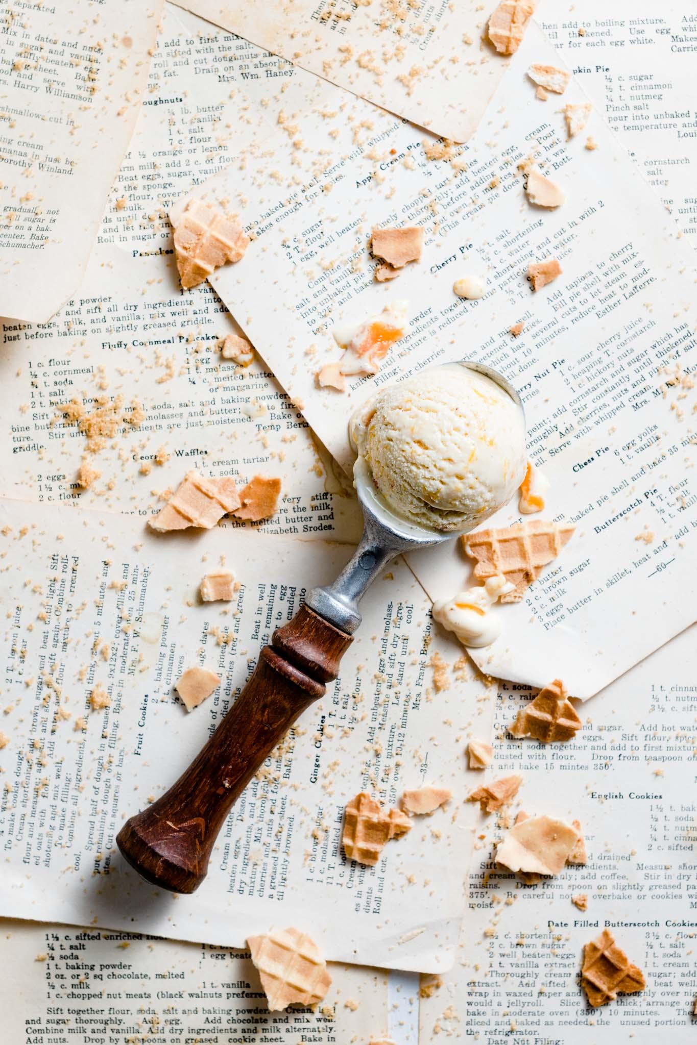 Ice cream scoop with peach ice cream.
