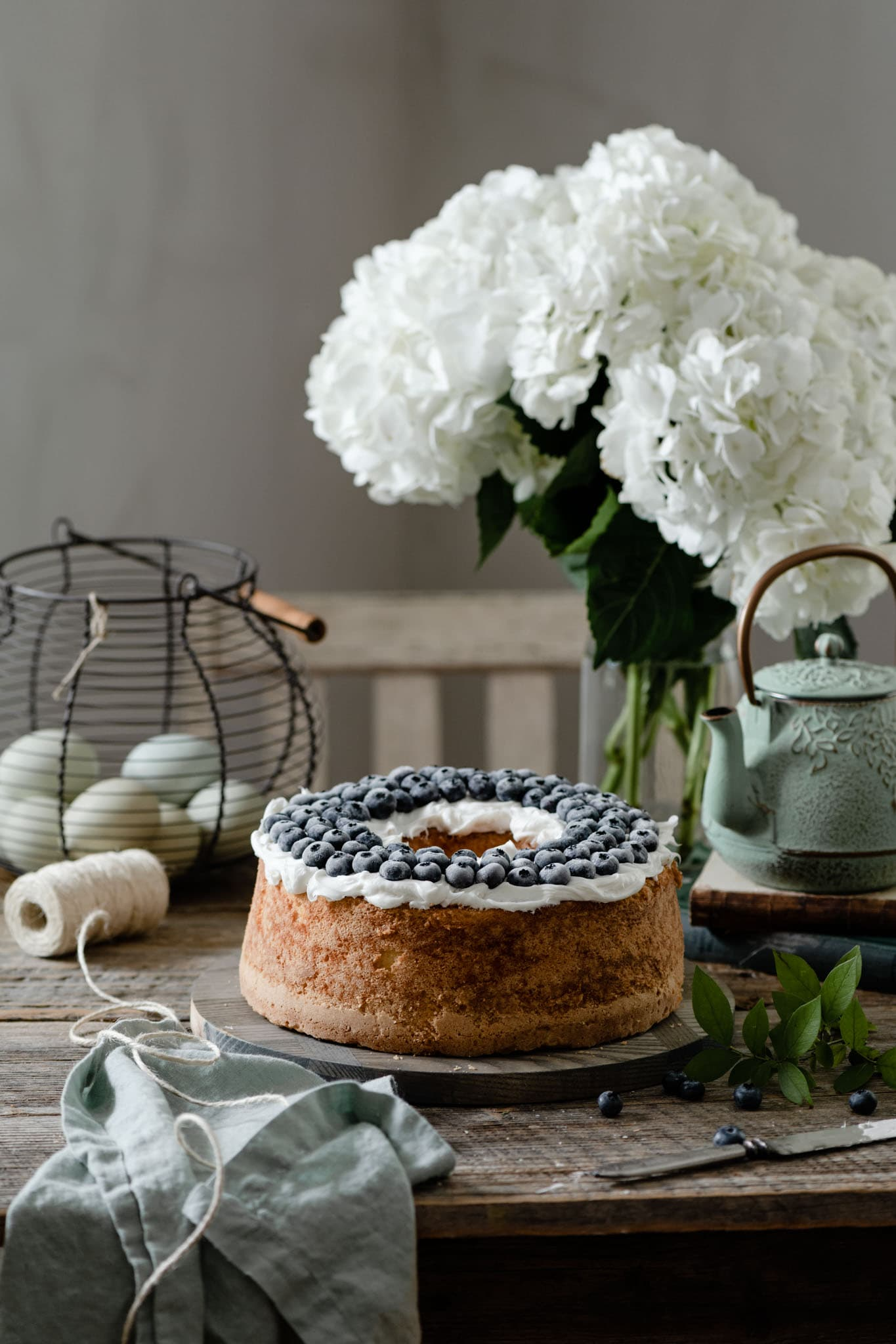Pound Cake topped with vanilla frosting and blueberries.