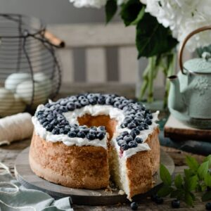 Vanilla Pound Cake topped with vanilla frosting and fresh blueberries.