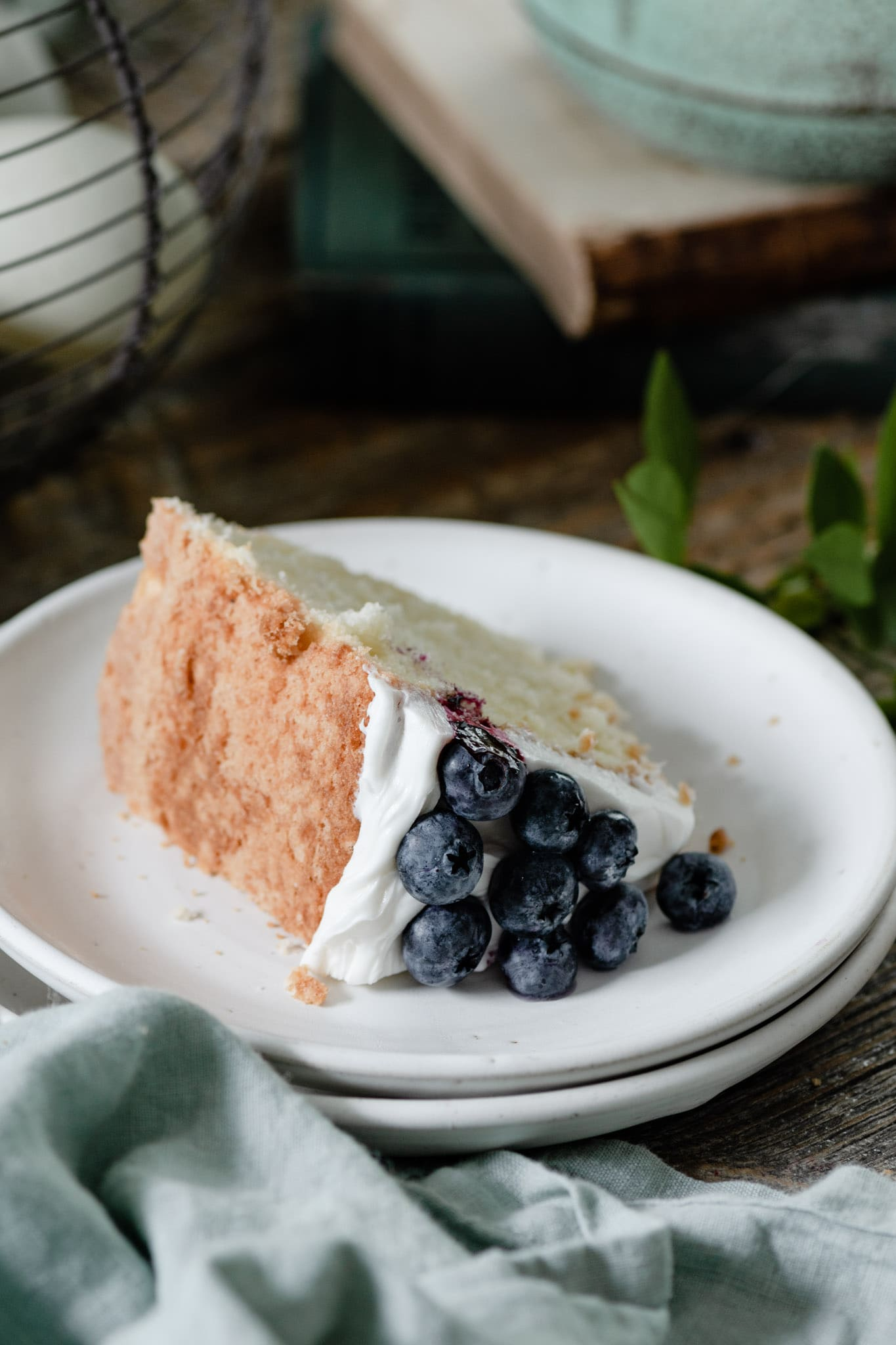 Slice of pound cake topped with blueberries.