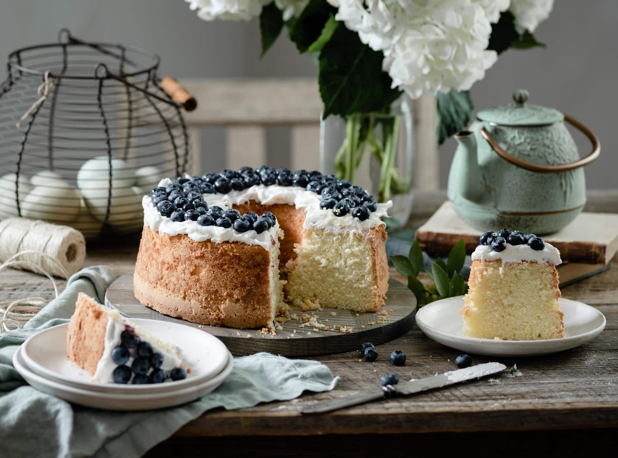 Sliced vanilla pound cake topped with blueberries.