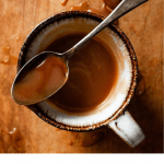 Homemade salted caramel sauce in a cup.