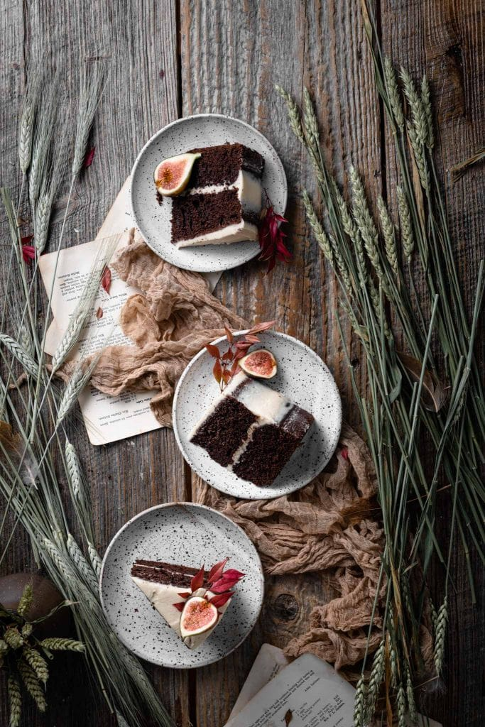 Three plates with slices of chocolate cake.