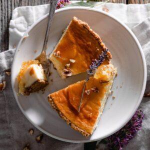 Slice honey cheesecake with pecans.