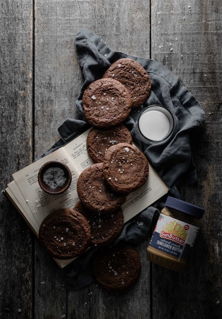 Chocolate cookies with jar of sunflower butter.