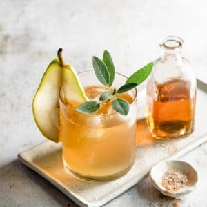 Pear Cocktail with a glass of bourbon.