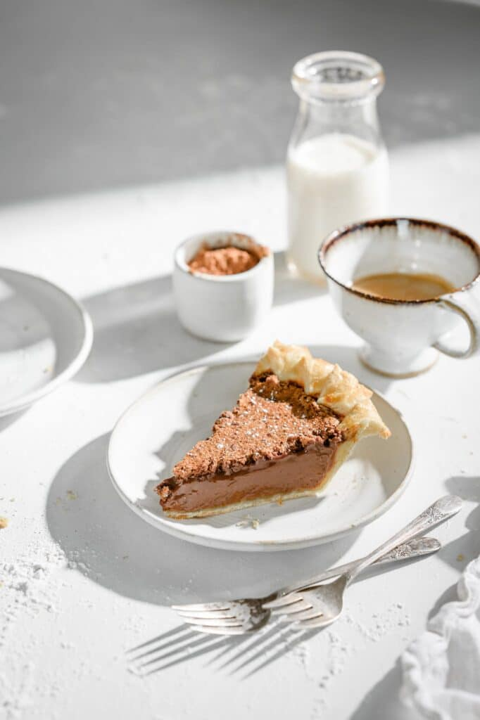 Chocolate Espresso Pie is a silky chocolate pie with coffee tones bakes in a homemade flaky pie crust. Easy chocolate pie recipe you will devour in no time. #chocolatepie #espressopie #easychocolatepie #twocupsflour