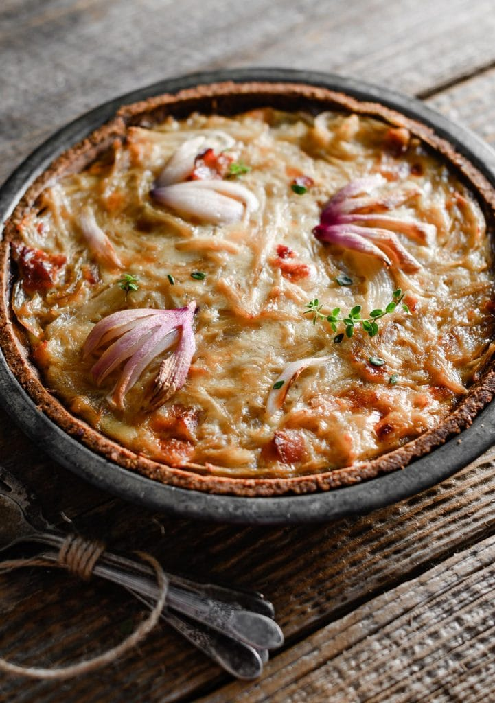 Close up of an onion tart in pie plate.