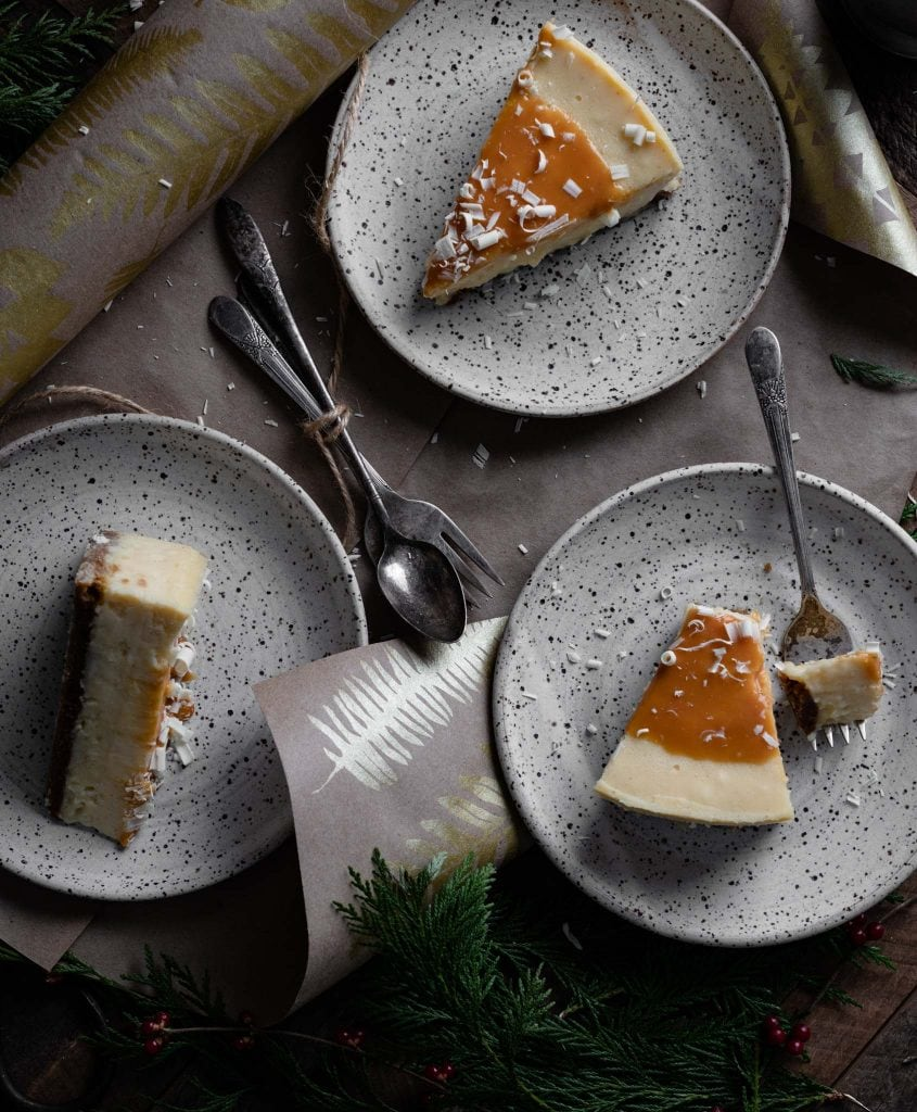 Three pieces of caramel topped cheesecake on table.