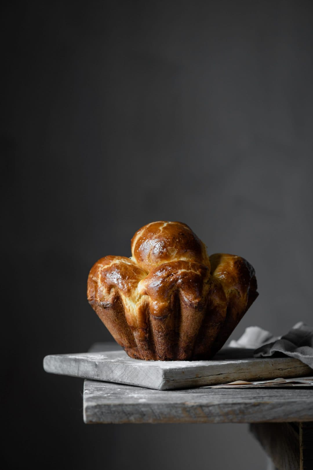 Brioche bread loaf on wooden table.
