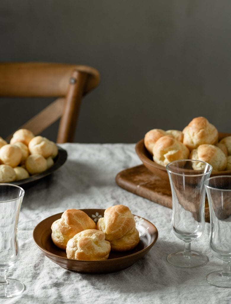 Bowl of cream puffs pastry on a table.