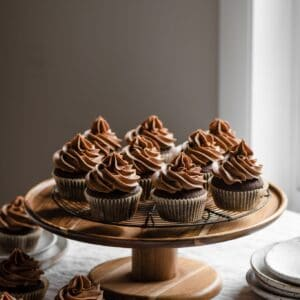 Chocolate cupcakes on a cake stand.