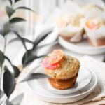 Muffin on a plate in the window.
