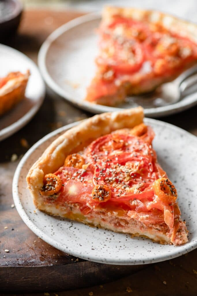 Closeup of a slice of tomato tart.