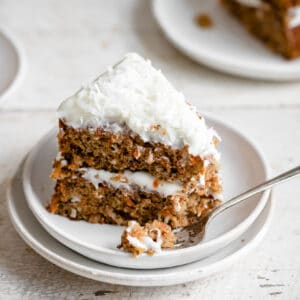Cloe up of asingle slice of cream cheese frosted carrot cake.