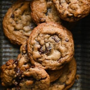 Closeup of rye chocolate chip cookies in a tin.