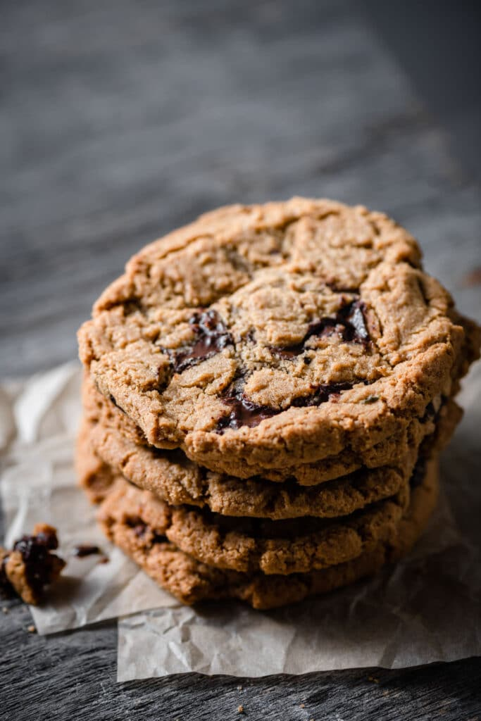 Stack of chocolate chip cookies on table.