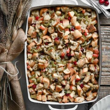 Closeup of baked apple stuffing in a casserole dish.