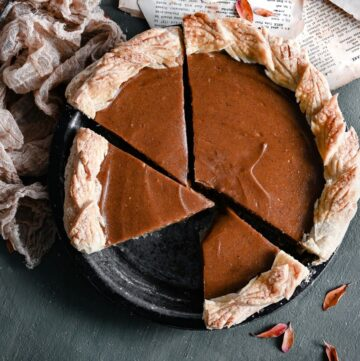 Up close image of bakes sweet potato pie in metal pan with slices cut.