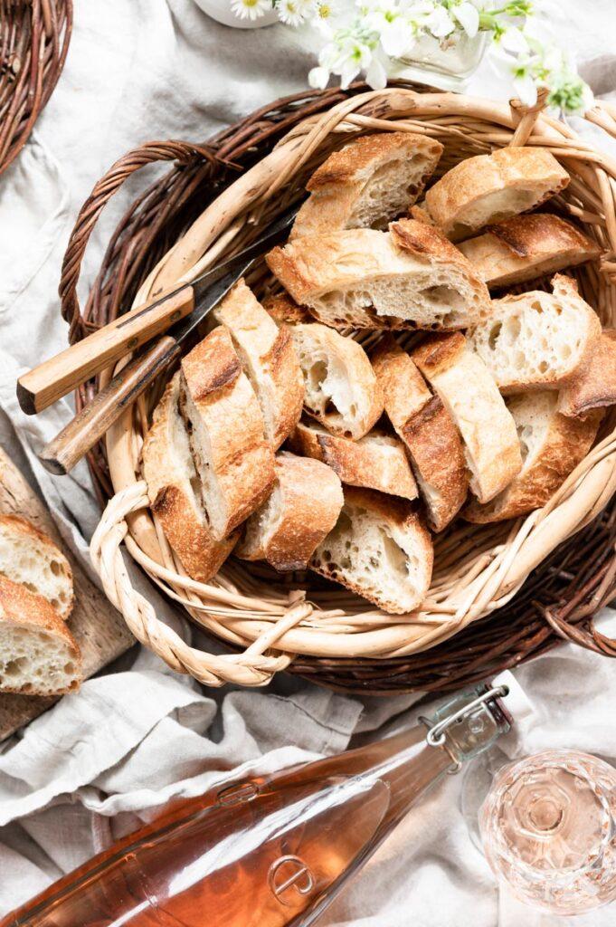 Sliced french baguettes i a basket.