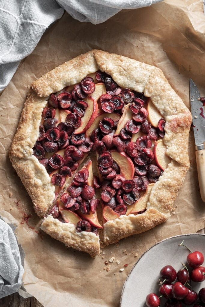 Open face galette filled with cherries and peaches.
