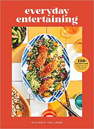 Cookbook cover for everyday entertaining with a plate of fish on salad.