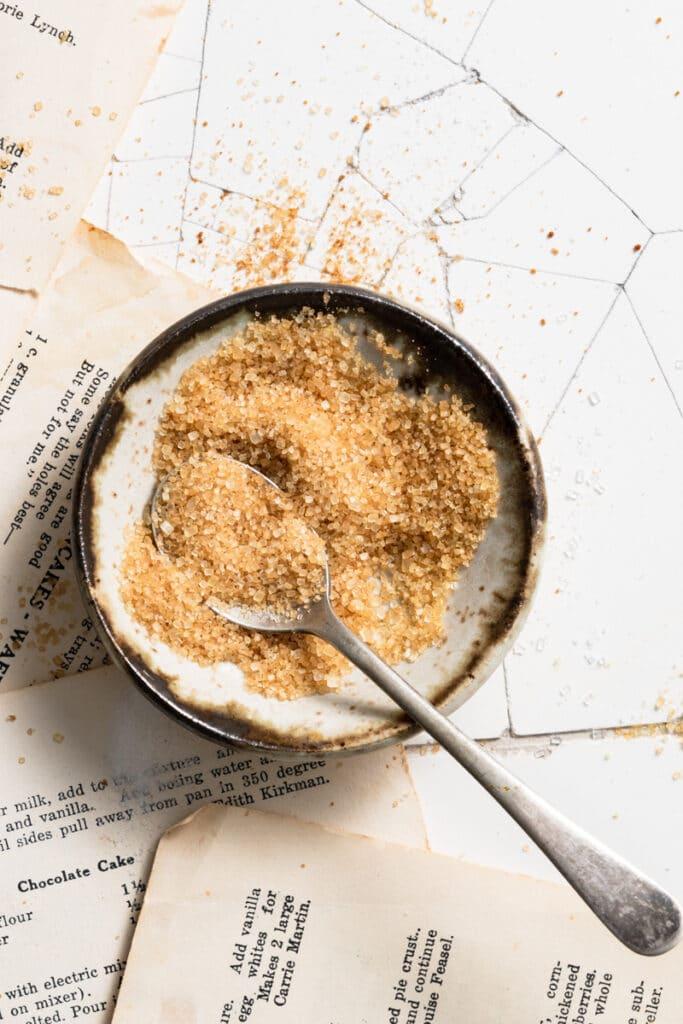 Small bowl of turbinado sugar with a spoon.